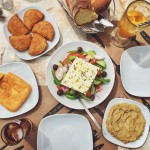 Greek lunch by the beach in the island of Aegina!…