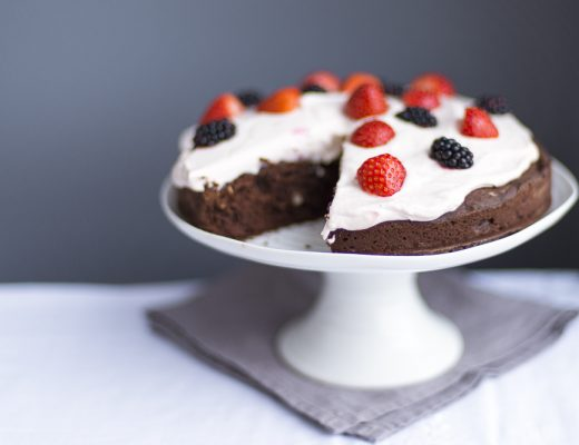 Cocoa Hazelnut cake with whipped cream and strawberries