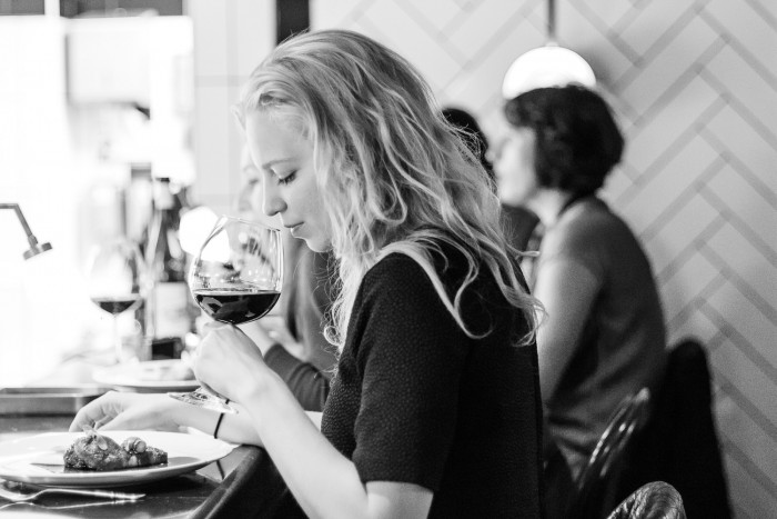 Woman with red wine at a London restaurant