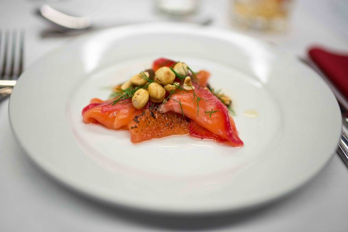 Caramelised grapefruit, roasted hazelnuts, camomile syrup, cured salmon, dill at Basement Galley Supperclub in London