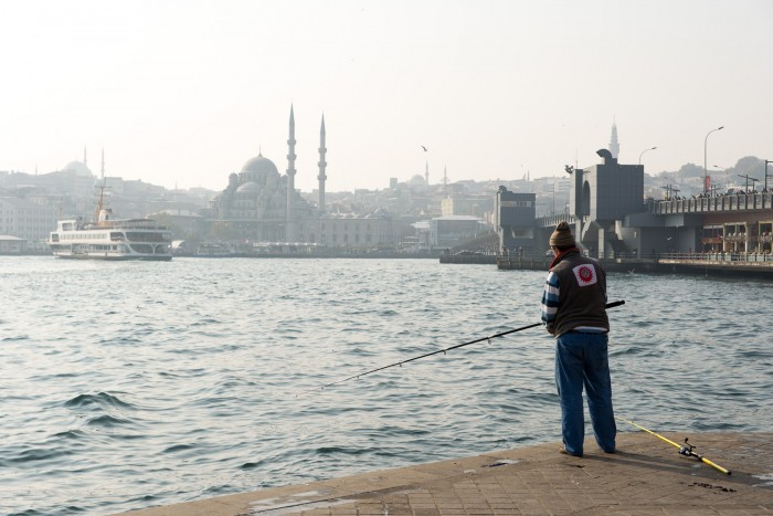 Fishermen by the Golden Horn and Bosphorus in Istanbul, Turkey
