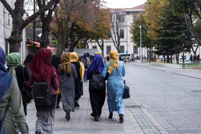 Muslim girls walking on the street in Istanbul, Turkey