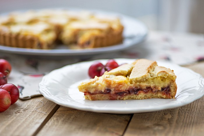A summer tart with red gooseberry jam and custard cream