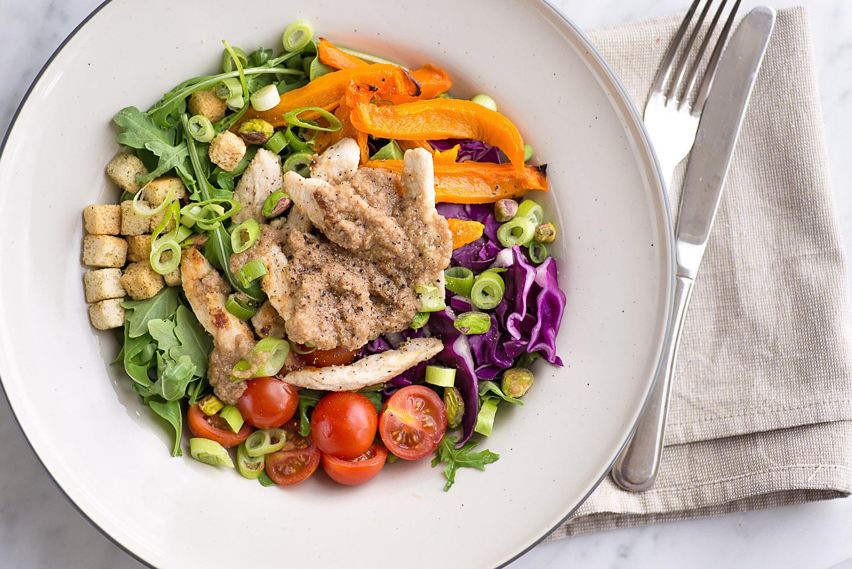 Chicken rainbow salad with Grana Padano cheese based vinaigrette
