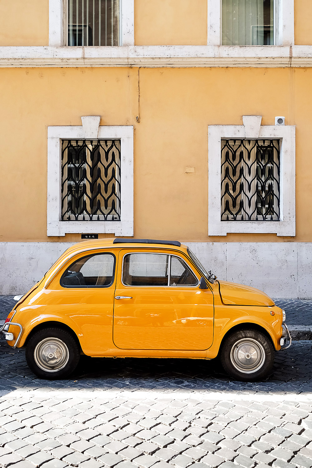 Yellow Fiat 500 car in Rome Italy