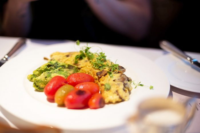 Cheese Omelette with cherry tomatoes, avocado at Sartoria in Mayfair, London
