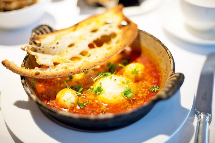 Eggs Purgatorio - Baked eggs, tomato sauce, crostini for breakfast at Sartoria in Mayfair, London