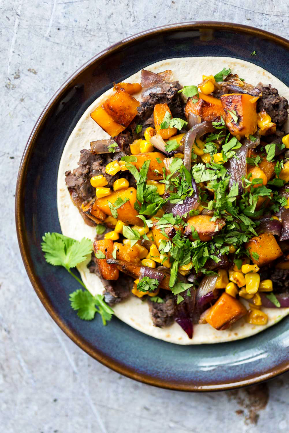 Veggie Tacos, refried black beans, roasted butternut squash and sweetcorn