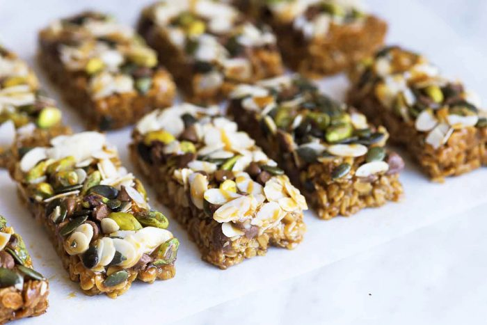 Oat Bars with Nuts, Chocolate Chips & Caramel Topping