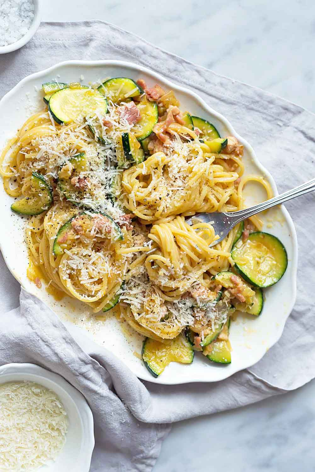 Spaghetti alla Carbonara with free range eggs, Pecorino cheese, pecone (or guanciale), extra virgin olive oil and courgettes (zucchini) - A classic pasta dish with a twist