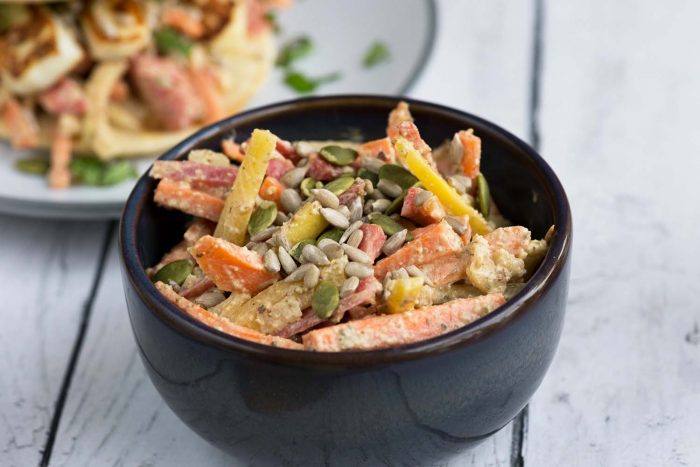 Jamie Oliver's 5 Ingredients cookbook: Tahini Carrot and Apple Slaw with pumpkin, sesame and sunflower seeds.