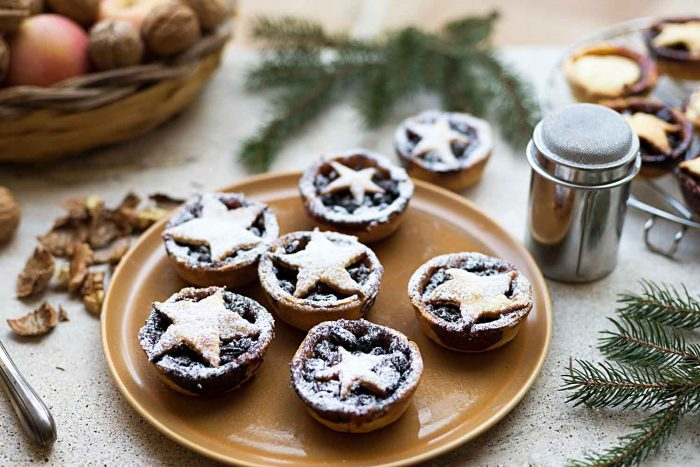 Traditional Christmas Mince Pies with shortcrust pastry filled with mincemeat (apples, butter, brandy, spices, citrus and dried fruits)
