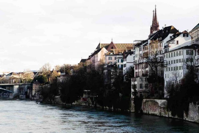 Basel is a city on the Rhine River in northwest Switzerland, close to the country's borders with France and Germany. Its medieval old town centers around Marktplatz, dominated by the 16th-century, red-sandstone Town Hall.