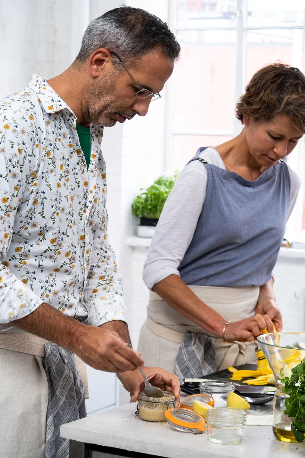 Chefs Yotam Ottolenghi and Tara Wigley cooking in London