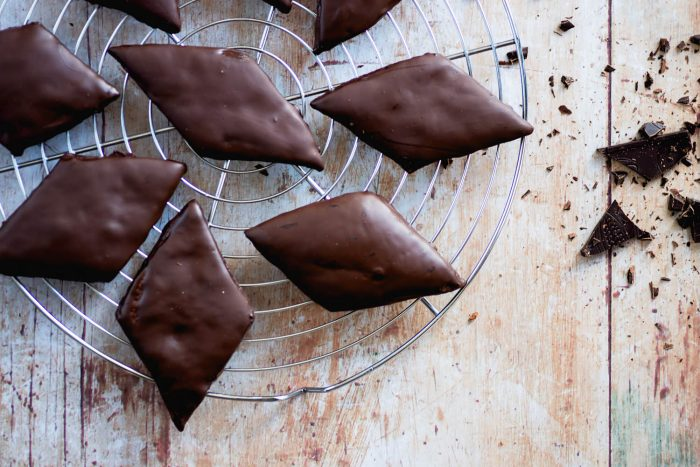Mostaccioli, or mustacciuoli, are rhombus-shaped spiced biscuits traditionally eaten at Christmas time in Naples and around other regions of southern Italy.