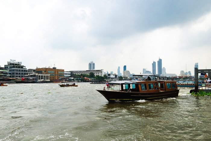 Crossing Chao Phraya River by boat in Bangkok, Thailand | A Four Day City Guide by Mondomulia