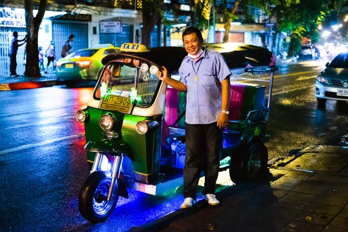 A tuk tuk at Night in the streets of Bangkok Thailand