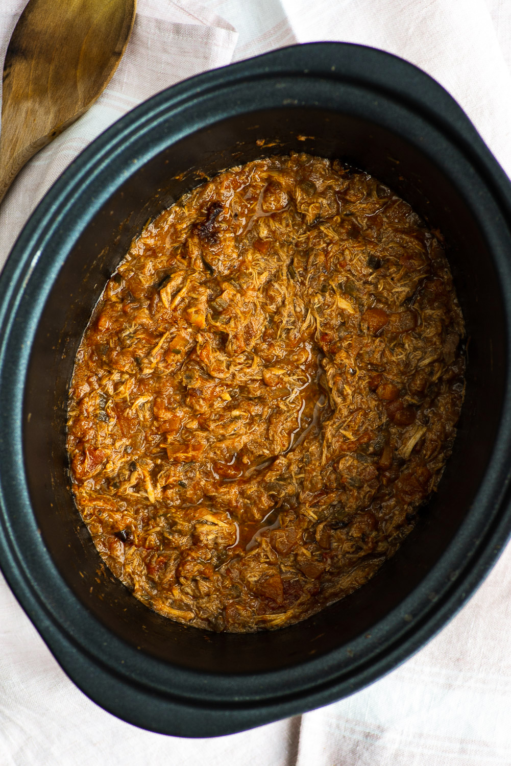 Slow cooked chicken sauce with chopped tomatoes and red wine