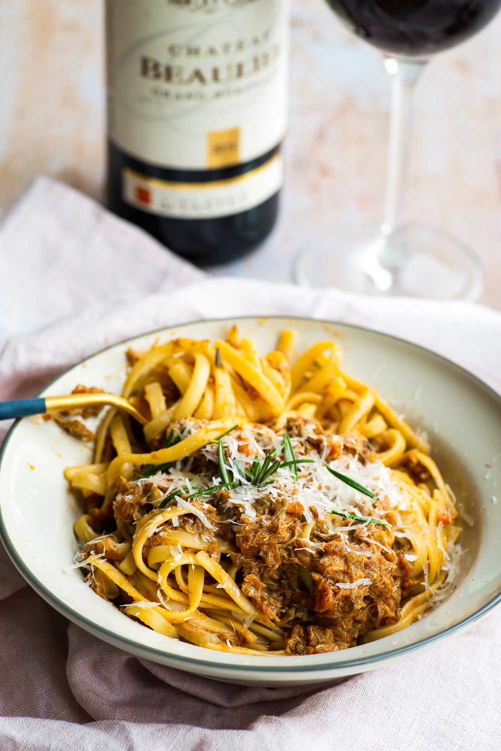 Linguine with slow cooked chicken sauce paired with Chateau Beaulieu red wine from Bordeaux