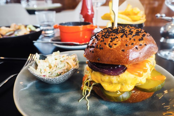 VIVI beef burger with grilled cheese & onions served with house slaw. - VIVI Restaurant & Bar at Centre Point in Tottenham Court Road, London