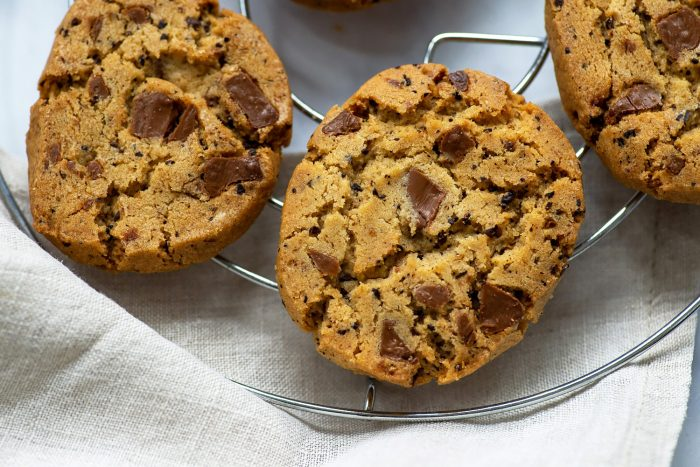 "Chocolate Chip Cookies with Coffee Beans featured in ""At Home – Middle Eastern recipes from our kitchen"", a cookbook by Itamar Srulovich and Sarit Packer."