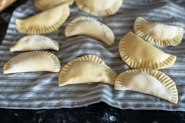 Pierogi Ruskie: vegetarian Polish dumplings with potatoes & cheese | Recipe from Wild Honey and Rye cookbook by Ren Behan | #mondomulia