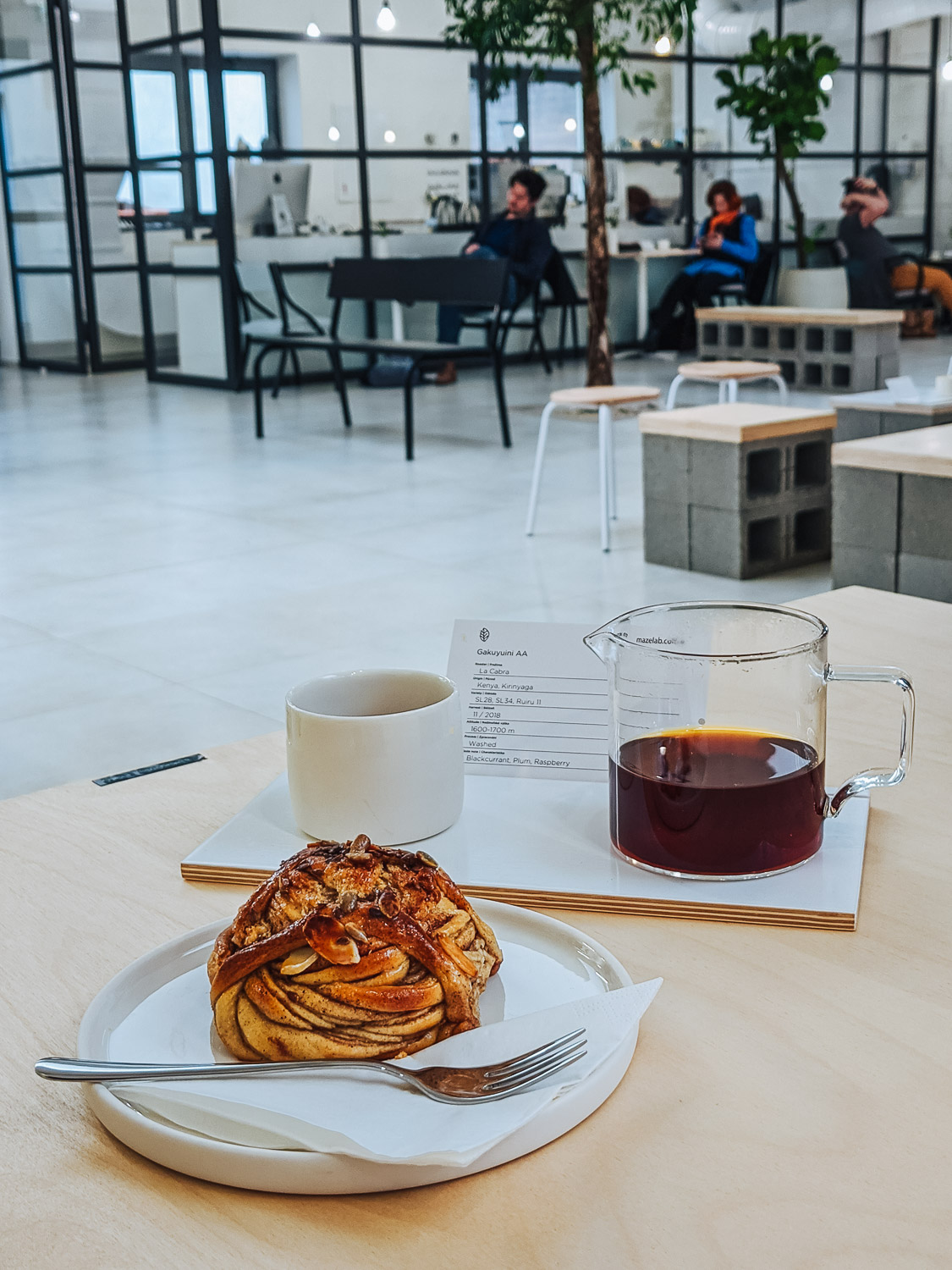 Cinnamon bun and speciality coffee pour over at Mazelab coffee shop in Prague