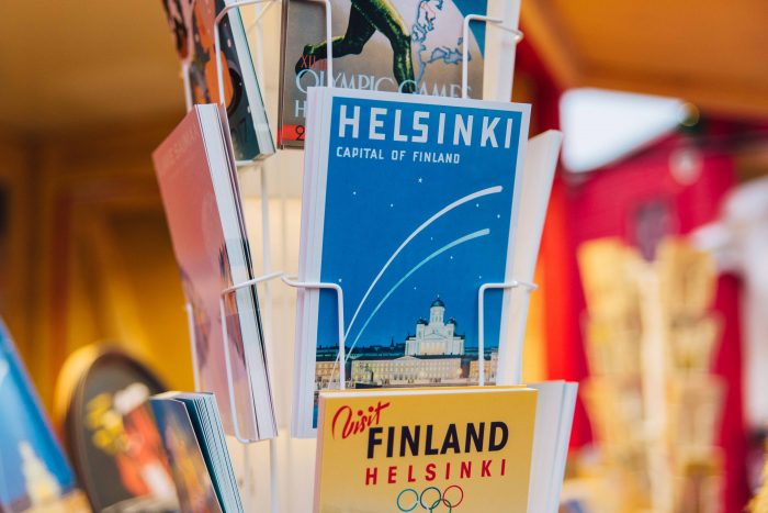 "Postcards depicting traditional ""travel posters of Finland"" at Manta's Christmas Market in Havis Amanda Square"