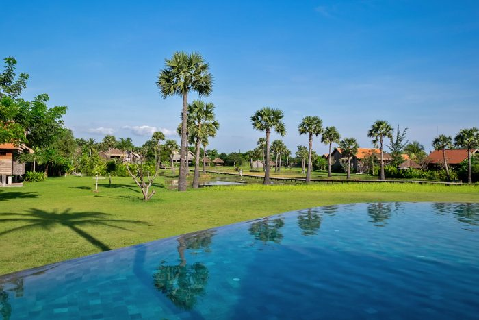 50-metre freshwater infinity pool overlooking paddy fields at Phum Baitang resort in Siem Reap, Cambodia | Mondomulia
