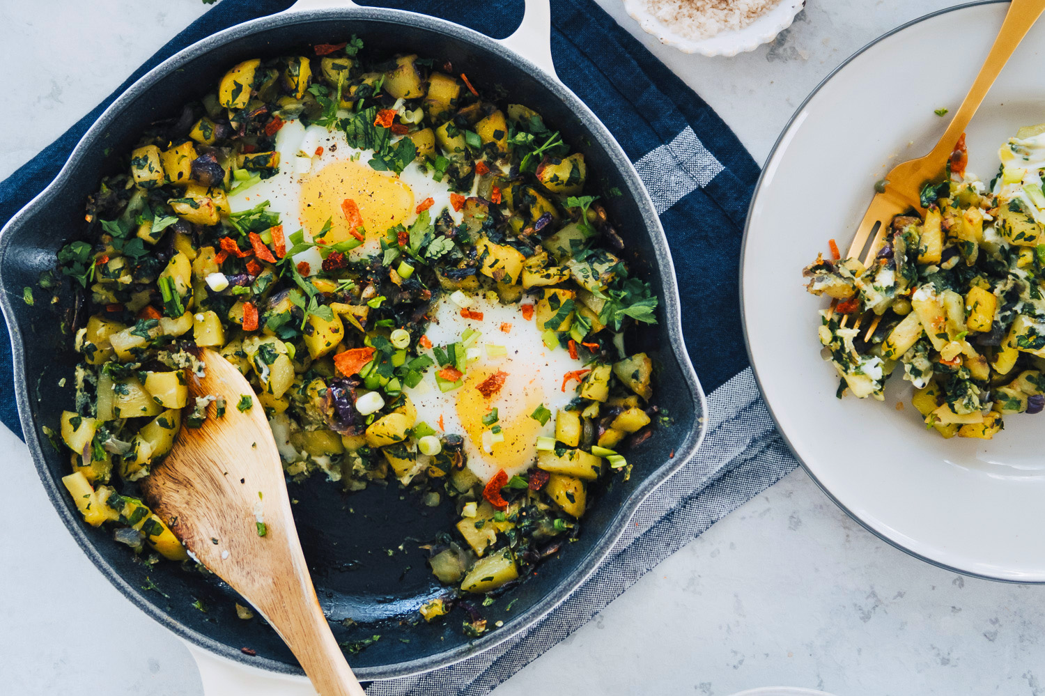 Potato Hash: an easy one-pan vegetarian traybake with crispy potatoes, spinach and set eggs with perfectly runny yolks