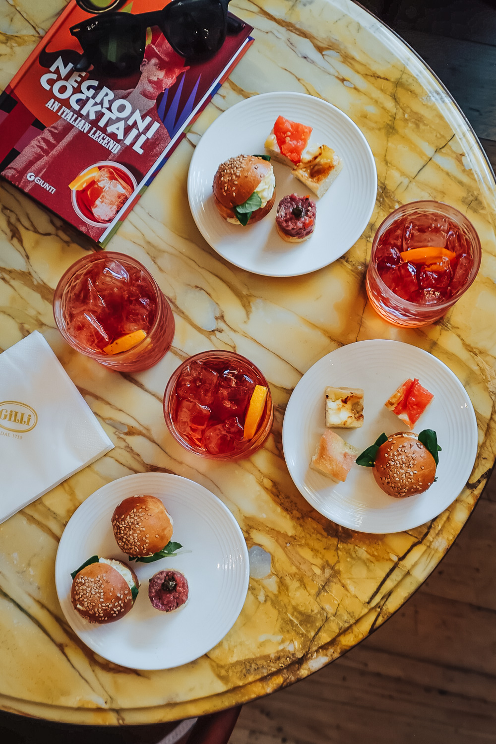Aperitivo with Negroni cocktails at Caffè Gilli in Florence, Italy