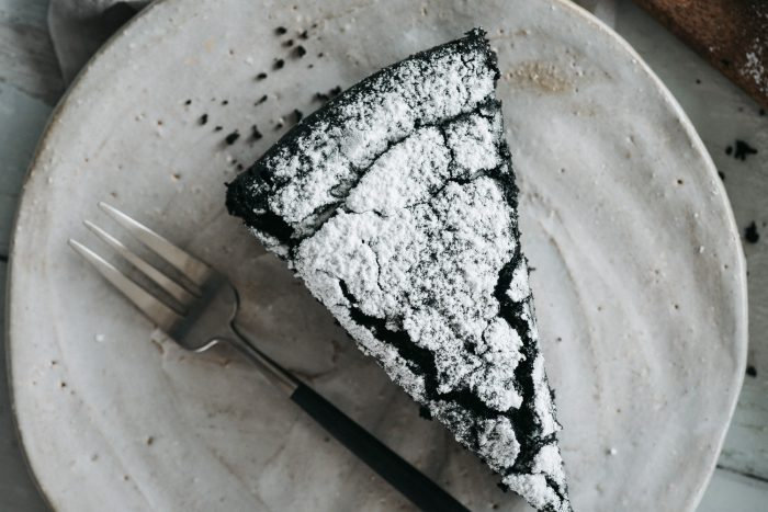 A chocolate cake recipe you are going to love: soft, rich, vegan dark chocolate cake, made without eggs and dairy. Delicious on its own, but perfect when topped with freshly whipped cream!