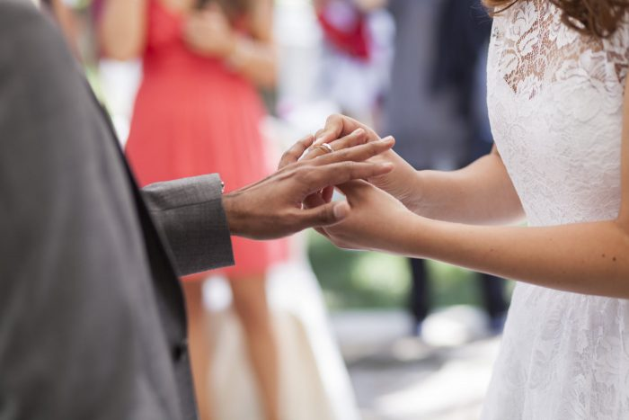 The exchange of rings at a wedding ceremony