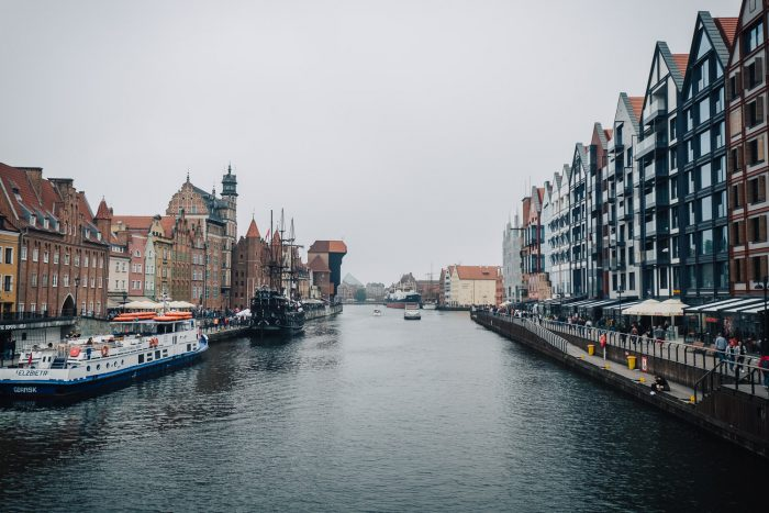The marina on Motlawa river in Gdansk, with the 15th century crane, the largest medieval crane in Europe.