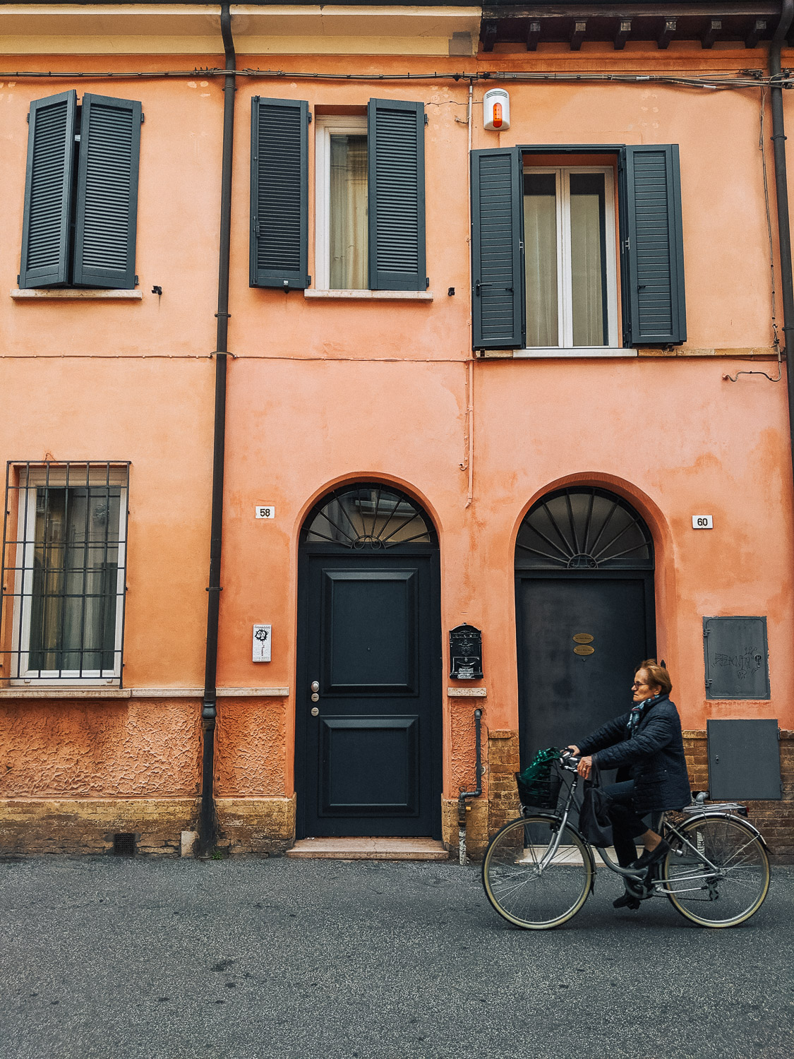 A woman on a bicycle on a street in Ravenna | Six Beautiful Places you Must Visit in Emilia Romagna | Mondomulia