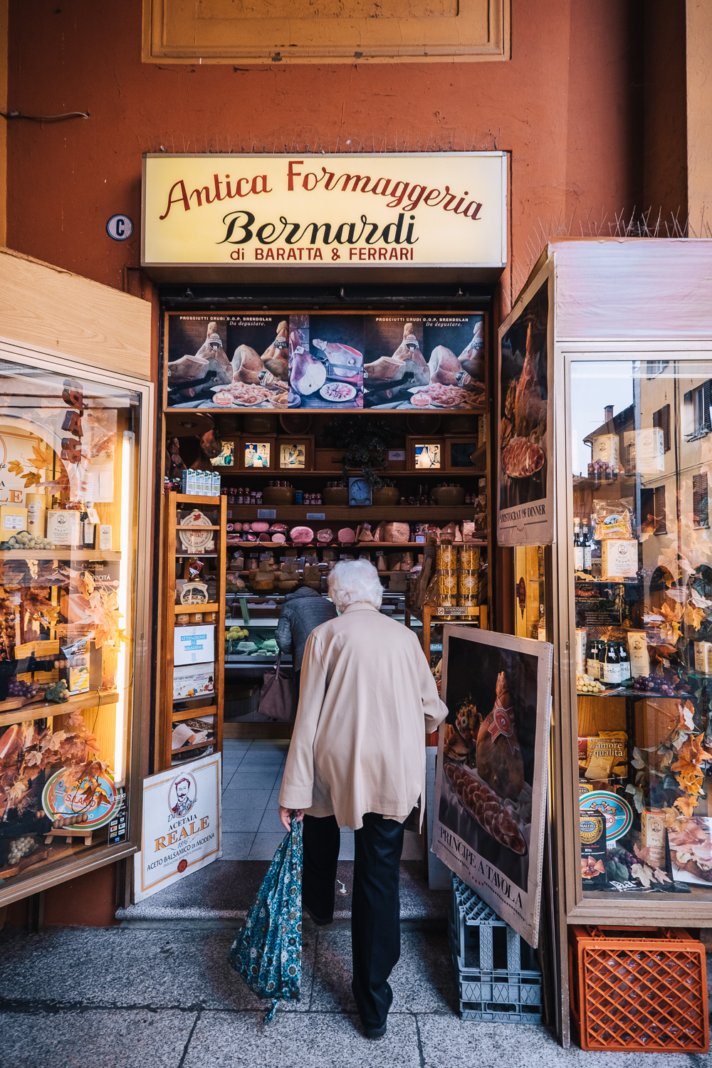A cheese shop at the entrance to Mercato delle Erbe food market in Bologna | Six Beautiful Places you Must Visit in Emilia Romagna | Mondomulia
