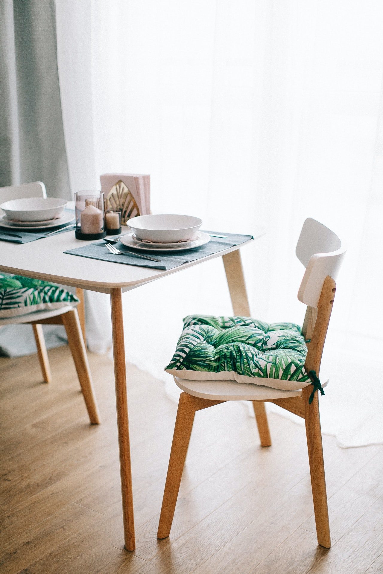 Dining table with plant print cushions