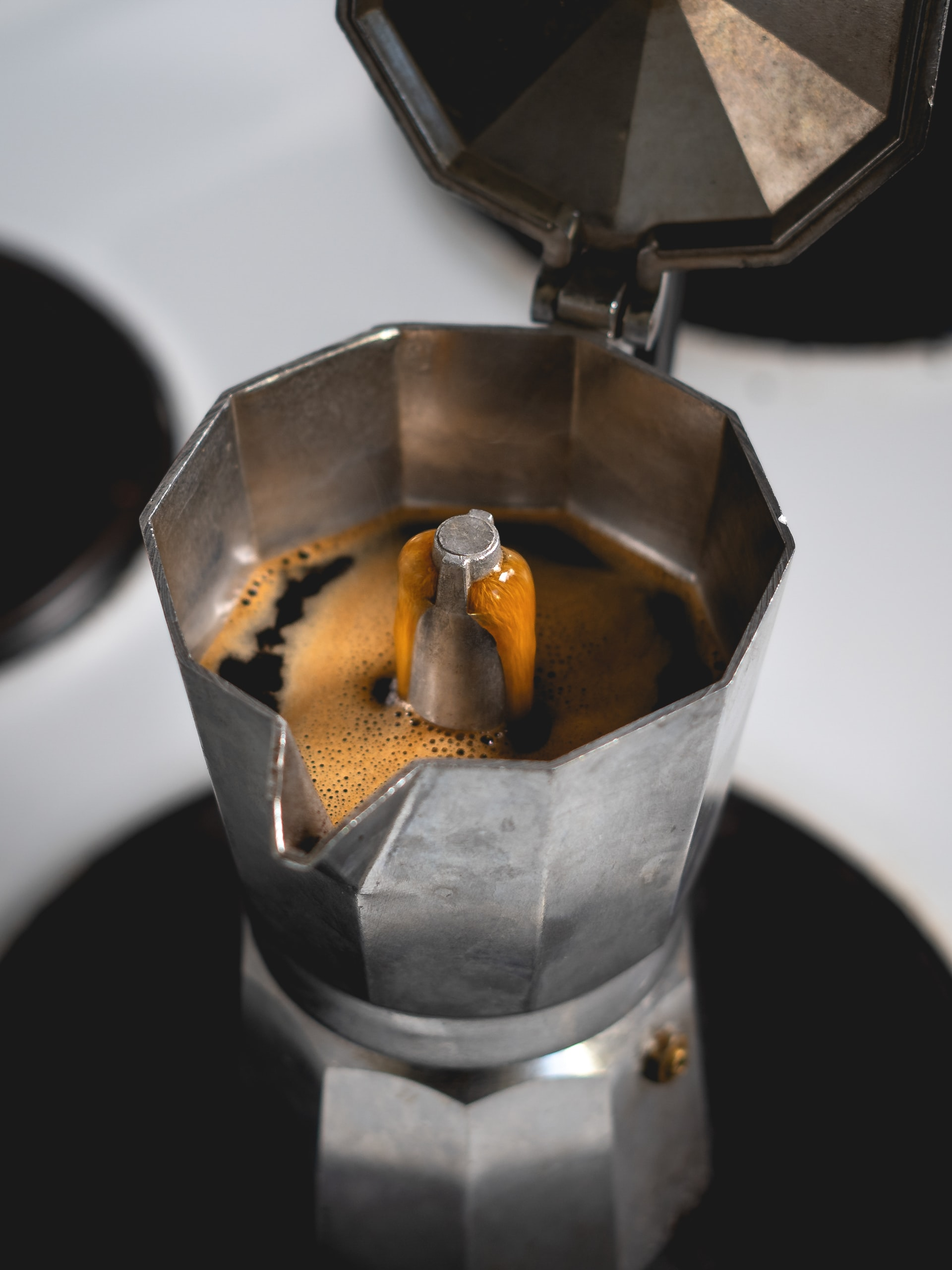 Espresso coffee brewing in a traditional moka pot machine