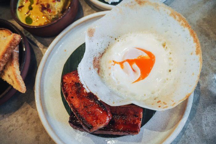 Cacklebean Egg Hopper with Kithul-glazed Bacon for brunch at Kolamba in Soho, London