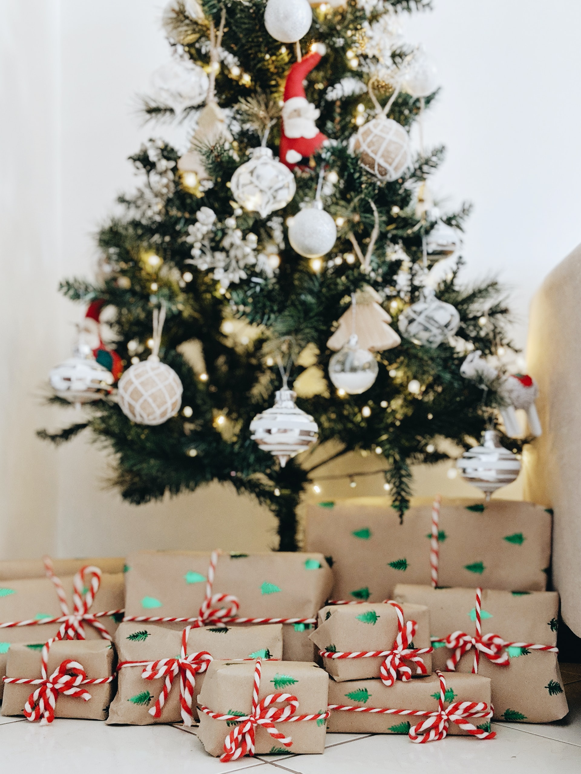 A Christmas tree and boxes of wrapped Christmas presents