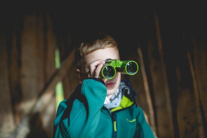A kid with binoculars
