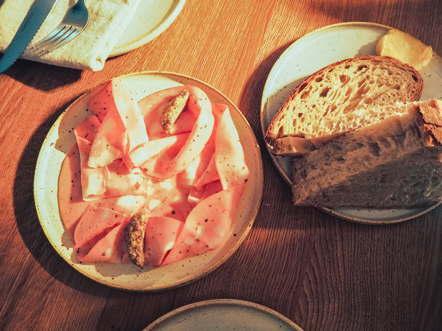 St John's Bakery sourdough bread with homemade cultured butter and Truffle mortadella with VB mustard - Milk Beach restaurant in Queen's Park, London