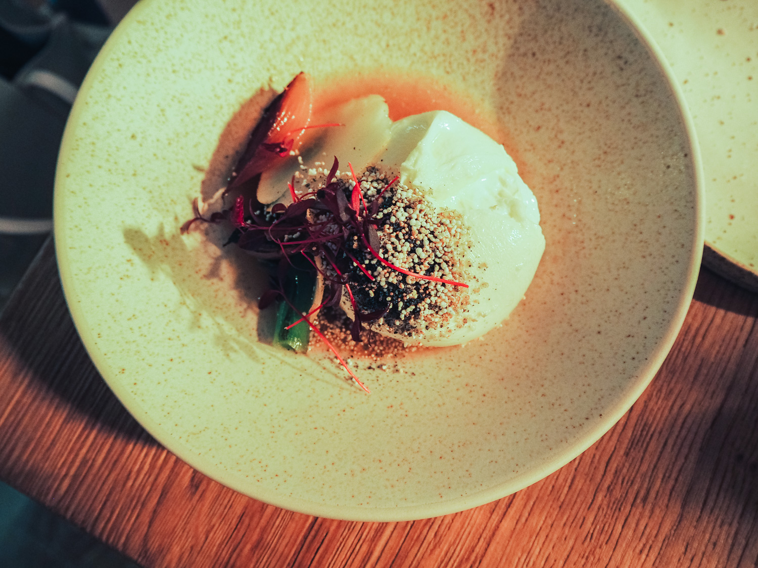 La Latteria burrata with Roscoff onions, Comace pears and amaranth at Milk Beach restaurant in Queen's Park, London