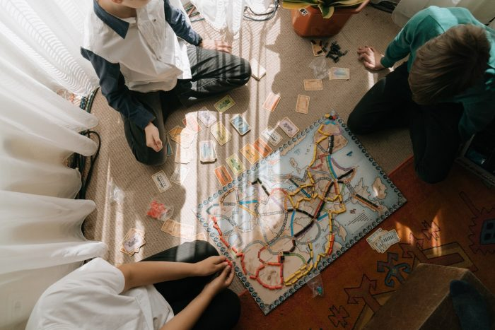 Kids playing a board game with cards
