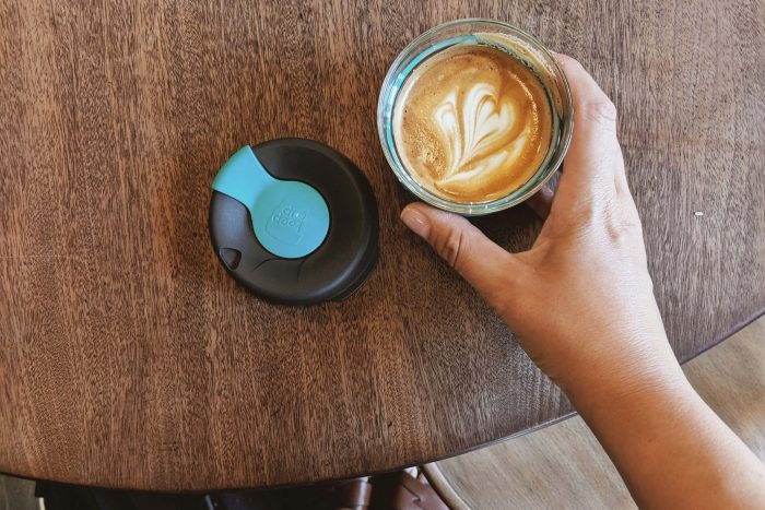 Flat white coffee in a reusable glass KeepCup