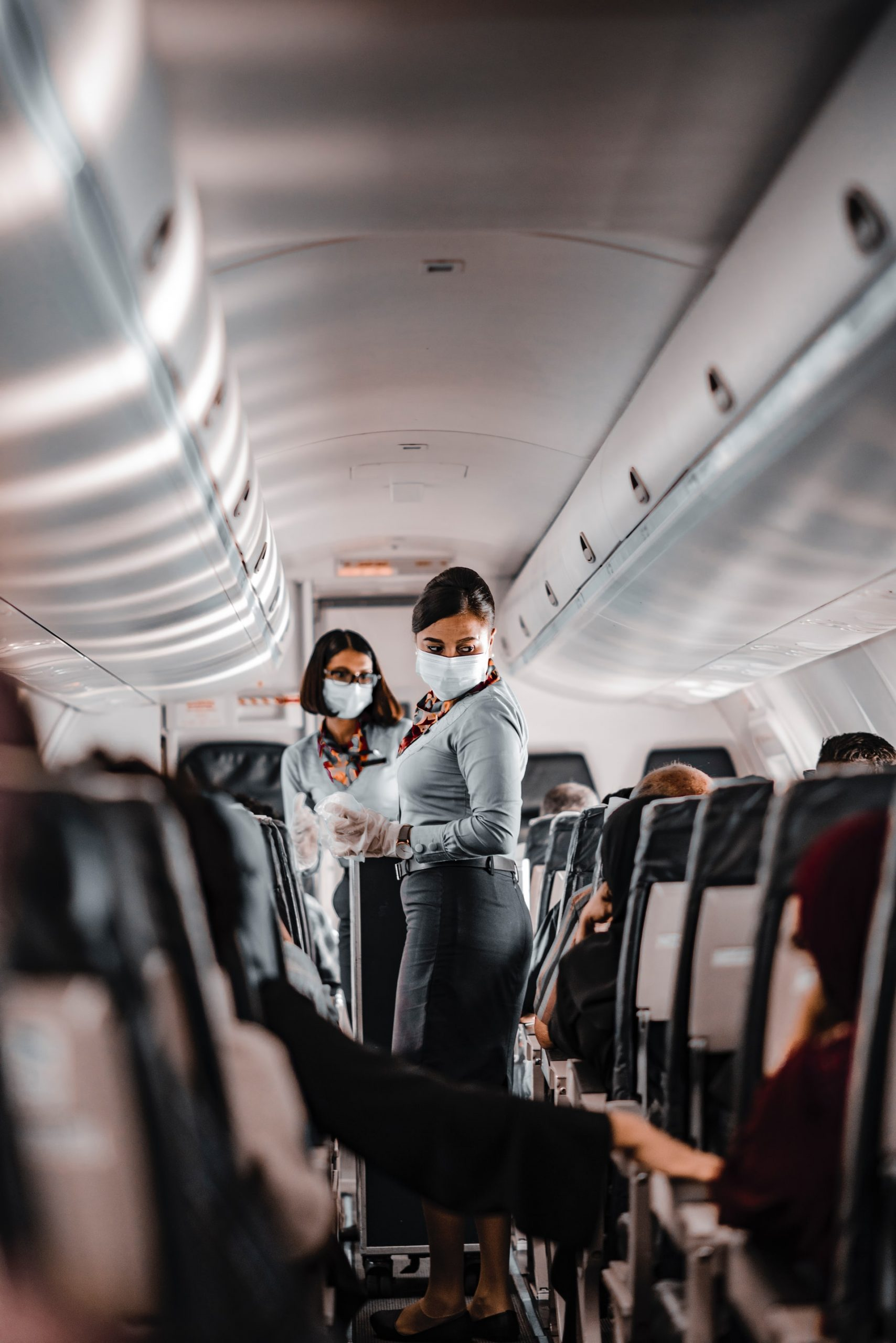 Flight attendants wearing face masks on a flight to Maldives