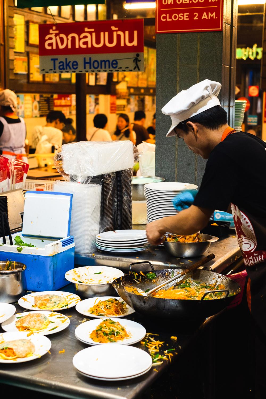 A chef cooking Pad Thai at Thip Samai restaurant in Bangkok