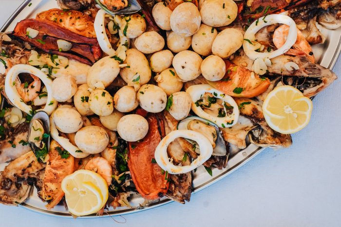 Seafood platter with Papas arrugadas, a traditional boiled potato dish of the Canary Islands.