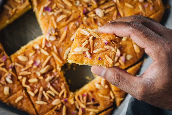 Revani is a classic dessert across Turkey, Greece and the Middle East. It is a dense semolina cake with a crumbly texture, soaked in a sugar and citrus syrup. #mondomulia
