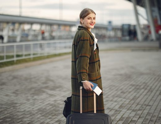 Woman travelling with suitcase